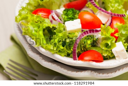 Salad with tomatoes, feta cheese and red onion - stock photo