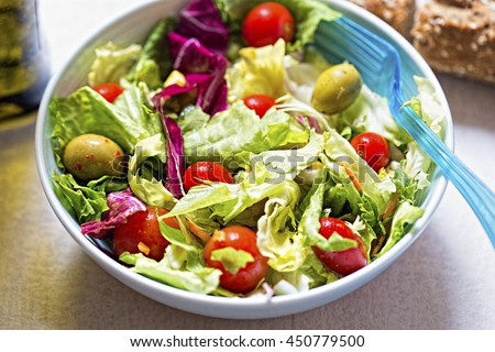 Salad with tomatoes, olives carrots