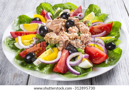 salad with tuna, classic recipe, french cuisine, close-up - stock photo
