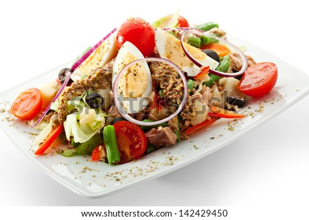 Salad with Tuna, Fresh Vegetables, Eggs, String Beans and Potato. Garnished with French Mustard - stock photo