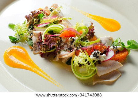 Salad with turkey fillet with baked pumpkin and ricotta truffle sauce - stock photo