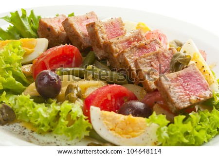 Salad with vegetables and bacon on white background