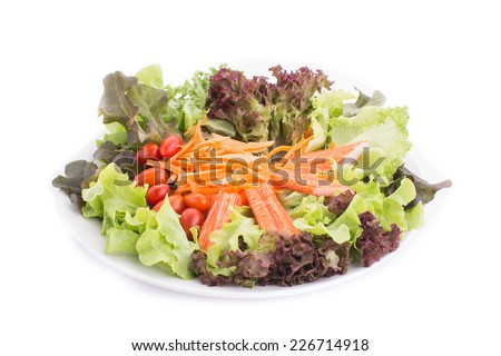 salad with vegetables and  Imitation Crab Stick and greens on white background