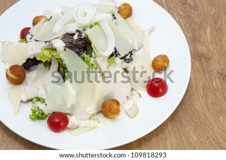 salad with vegetables, meat and cheese