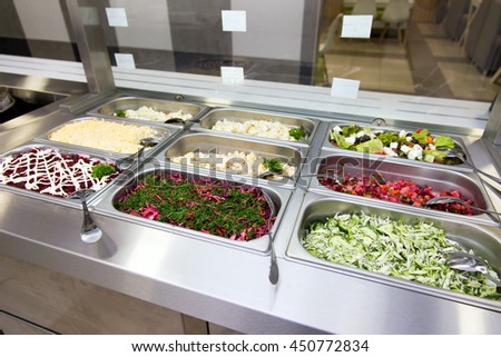 Salads in buffet on the metal plates. selective focus