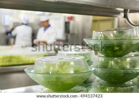 Salads Prepped with Chefs in Background