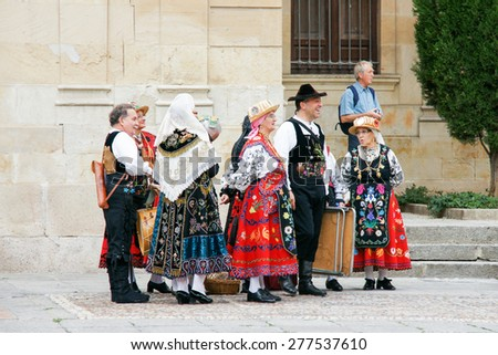 SALAMANCA, SPAIN - SEPTEMBER 8: Unidentified people with traditional costumes in Cathedral Square on September 8, 2012 in Salamanca, Spain. It was declared a UNESCO World Heritage Site in 1988. - stock photo