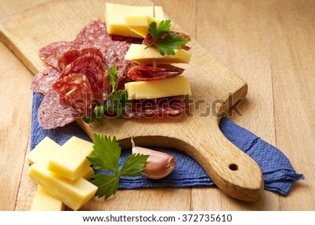 salami and cheese for an appetizer - stock photo
