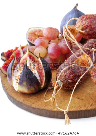 Salami and figs with grapes and cheese.