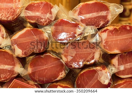 salami mortadella trotter cured pork meat products typical of the Po Valley Italian delicatessen - stock photo