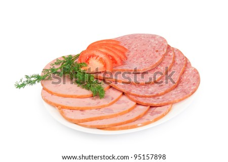 Salami on a plate with fennel and tomato - stock photo