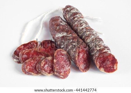 Salami sausages sliced on a white background