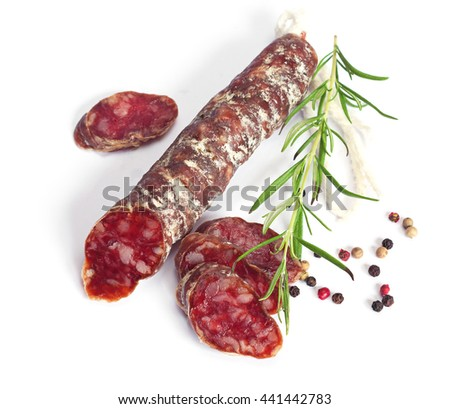 Salami sausages sliced with pepper and rosemary on white background