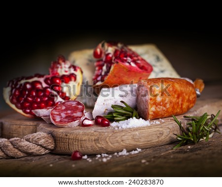 salami with spice sliced on wooden table - stock photo