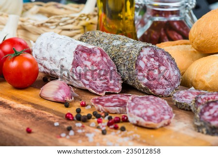 salami with spices - stock photo