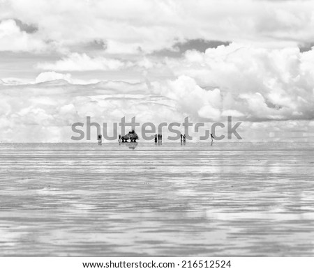 Salar de Uyuni is largest salt flat in the World - Altiplano, Bolivia, South America (black and white) - stock photo