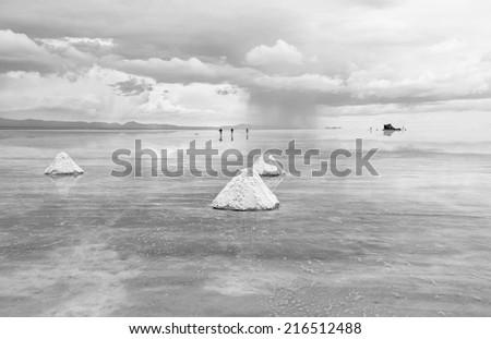 Salar de Uyuni is largest salt flat in the World (UNESCO World Heritage Site) - Altiplano, Bolivia, South America (black and white) - stock photo