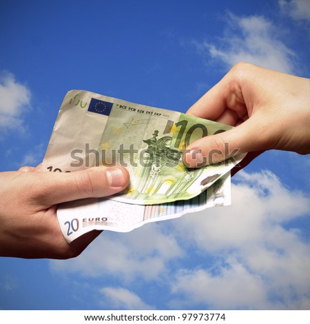 Salary by euro on the sky background - stock photo
