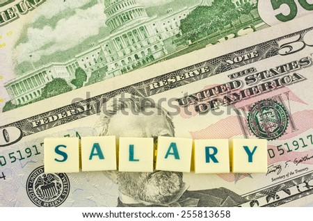 Salary word on dollar background. Finance concept