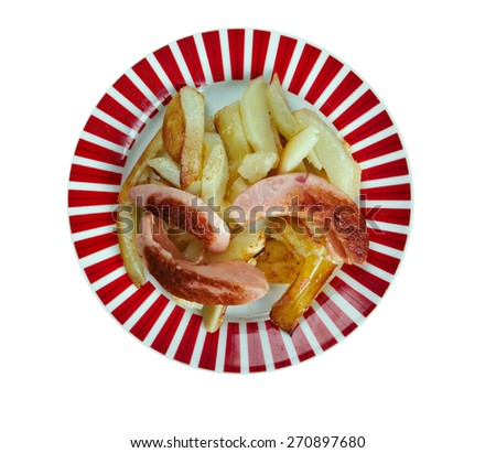 Salchipapas -  fast food dish , street food throughout Latin America.consist of thinly sliced pan-fried beef sausages and French fries - stock photo