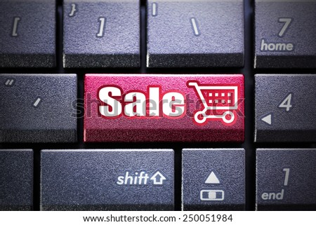 Sale button on the computer keyboard - stock photo