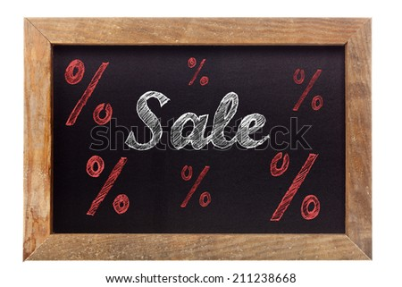 Sale chalk writing with percentage signs on old vintage black chalkboard - stock photo