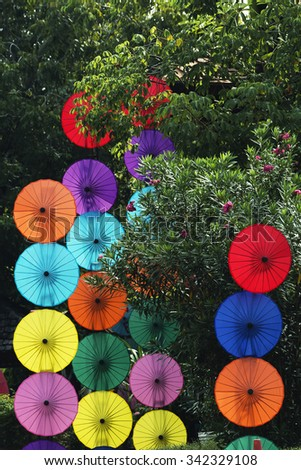 sale colorful umbrellas made of paper in traditional style handmade in Thailand - stock photo