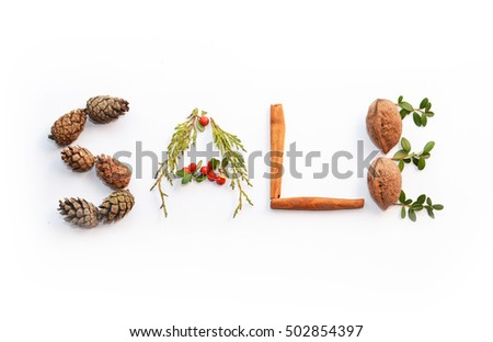 Sale concept made of colorful christmas staff : nuts, pine cones, cinnamon, star anise isolated over white, on white background. For christmas shopping, sales, advertising, discounts and promotion.