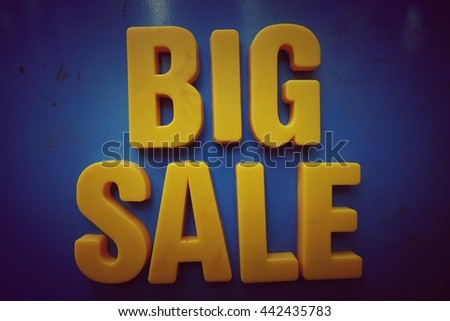 Sale concept. Yellow letters on blue background