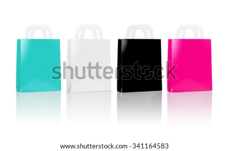sale, consumerism, advertisement and retail concept - many blank shopping bags, blue white black pink color