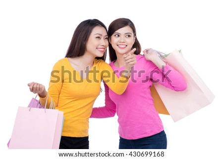 Sale, consumerism and people concept - happy young women with shopping bags - stock photo