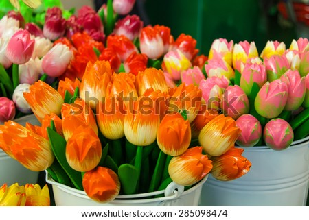 Sale of artificial souvenir Dutch tulips, Netherlands - stock photo