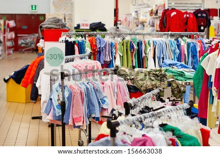 sale of children's wear in the supermarket - stock photo