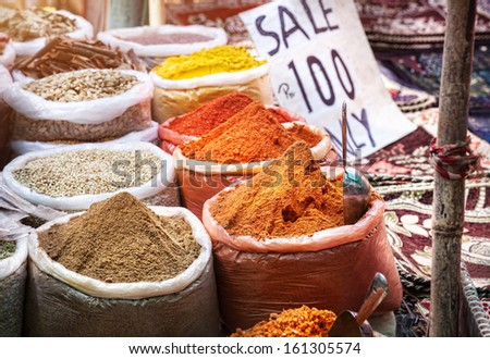 Sale of Indian colorful spices at Anjuna flea market in Goa, India - stock photo
