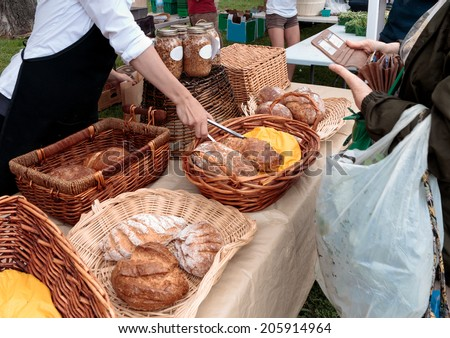 Sale of organic loaves at outdoor farmers market - stock photo