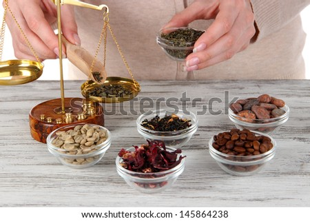 Sale of tea and different spices - stock photo