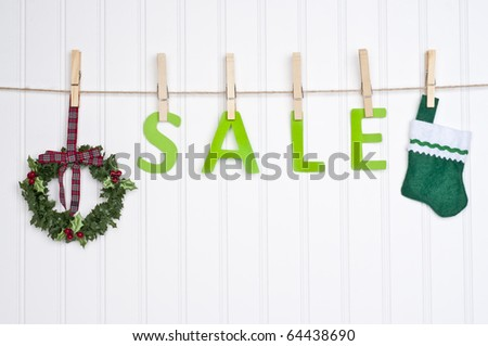 SALE on a Clothesline with a Wreath and Stocking.  Holiday Concept.