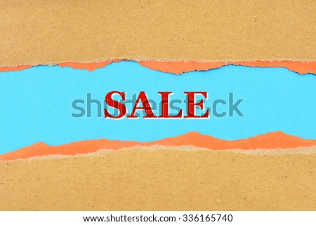 SALE on a torn paper - stock photo