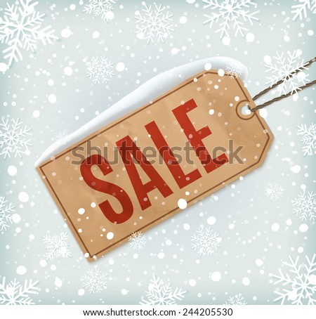 Sale paper tag on background with snowflakes and snow. Winter sale. Christmas sale. New year sale - stock photo