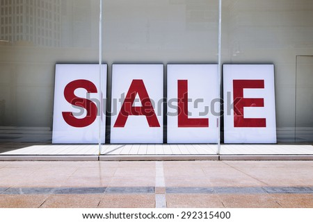 sale poster in shop display window - stock photo
