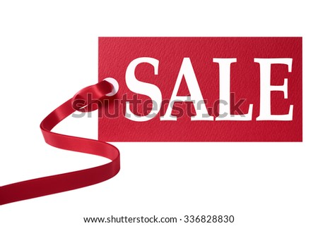 Sale price tag, red ribbon isolated on white.