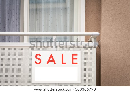 Sale Real Estate Sign in Front of house - stock photo