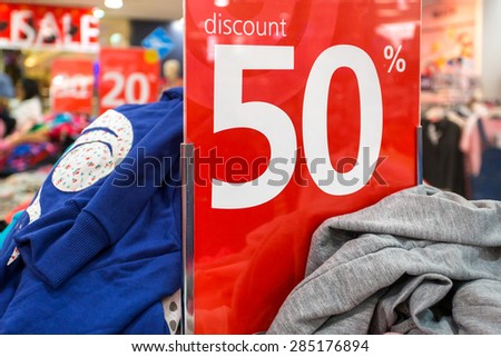 Sale sign in the clothing shop - stock photo