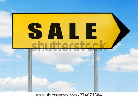 Sale Sign -Yellow road sign with arrow pointing right against blue cloudy sky - stock photo