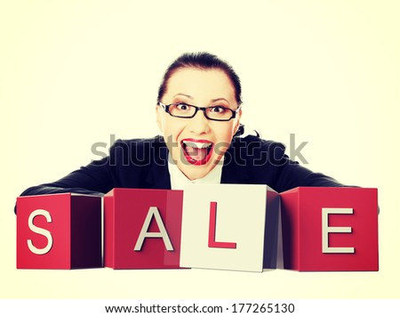 Sale time. Businesswoman with sale sign, isolated on white.