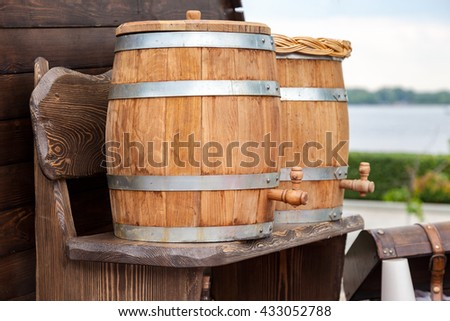 Sale traditional Russian kvass from wooden barrels - stock photo