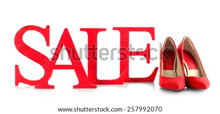 Sale with shoes isolated on white - stock photo