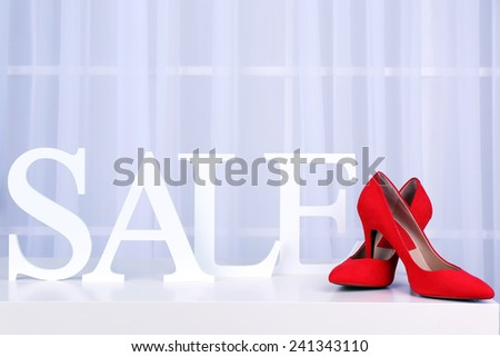 Sale with shoes on bright background - stock photo