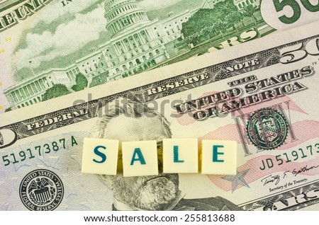 Sale word on dollar background. Finance concept