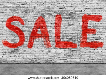 Sale word painted on white brick wall - stock photo